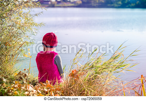 sitting by the pond - csp72065059