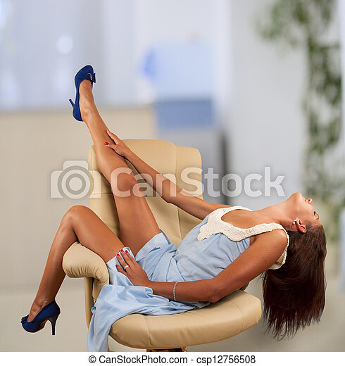 sitting in chair - csp12756508