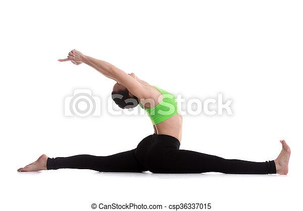 sitting in splits yoga exercise fitness girl on white