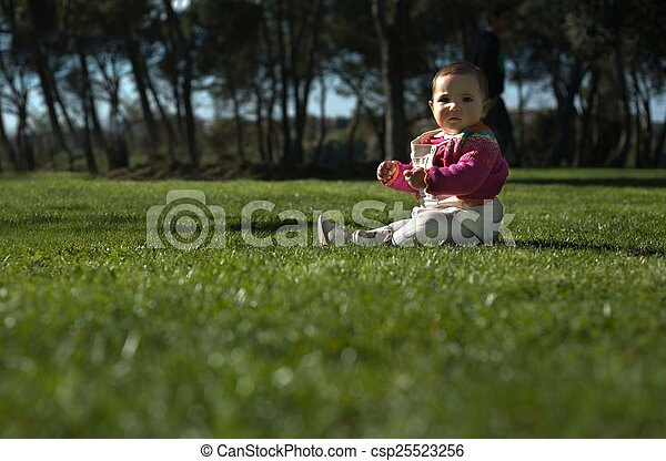 Sitting in the grass - csp25523256