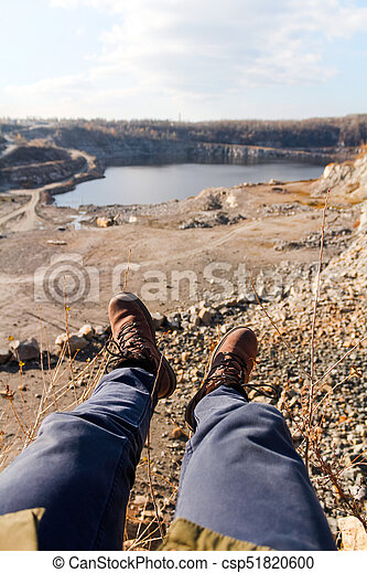 sitting on a cliff - csp51820600