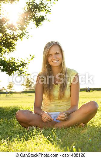 sitting on grass - csp1488126