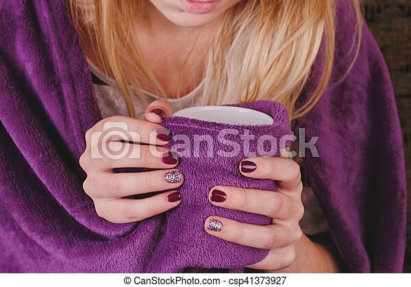 sitting on sofa in livingroom with tea - csp41373927