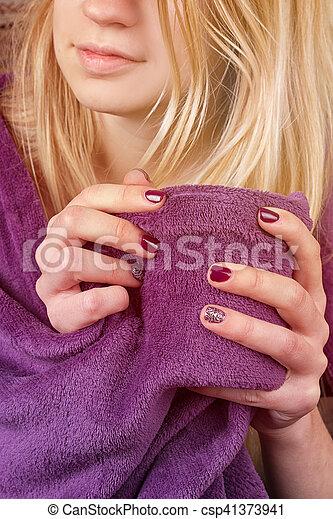 sitting on sofa in livingroom with tea - csp41373941