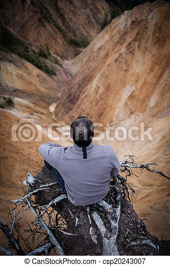 Sitting on the edge of a cliff - csp20243007