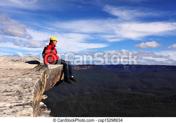 Sitting on Top of the World - hiker rests and admires views of Blue Mountains on a beautiful sunny day. Selective focus. - csp15298634