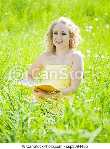 Sitting woman reading a book - csp3894485