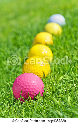 six golf balls on the green grass - csp4357329