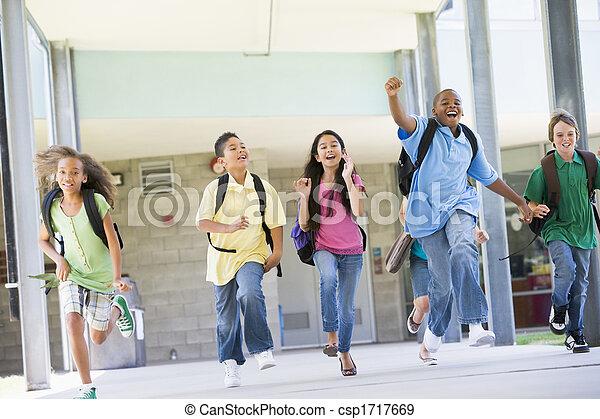 Six students running away from front door of school excited - csp1717669