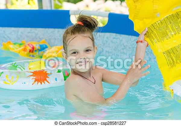 Six year old girl bathing in pool - csp28581227