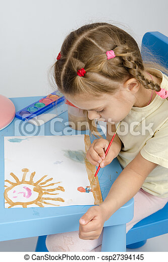 Six year old girl draws a paint something in the picture - csp27394145