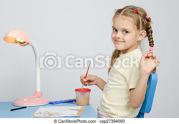 Six year old girl draws paints and waves - csp27394093