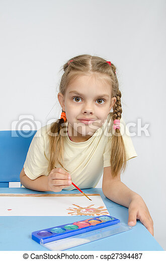 Six year old girl draws paints the sun - csp27394487