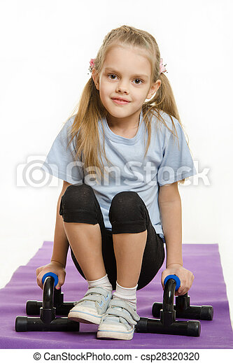 Six year old girl hanging on the palm pushups - csp28320320