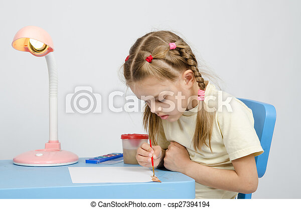 Six year old girl keen on drawing - csp27394194