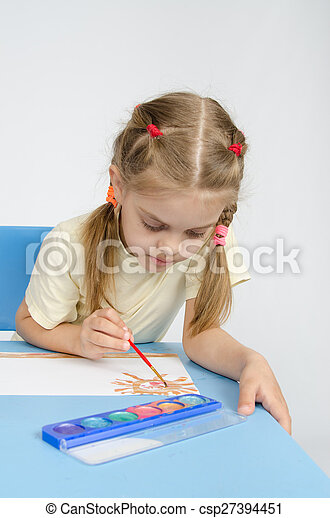 Six year old girl sitting at the table and draws paints - csp27394451