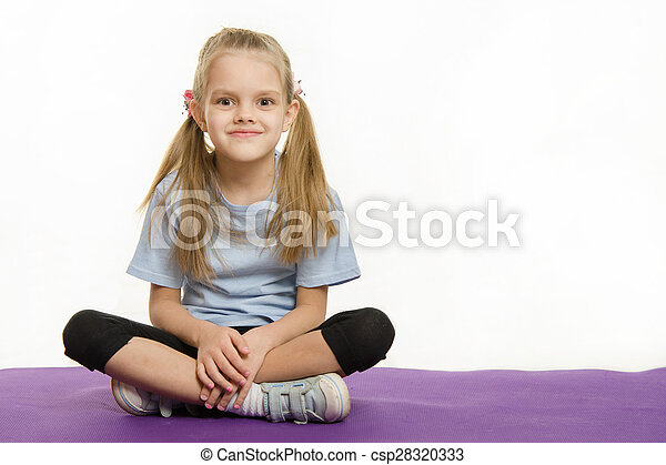 Six year old girl sitting on the mat for practice - csp28320333