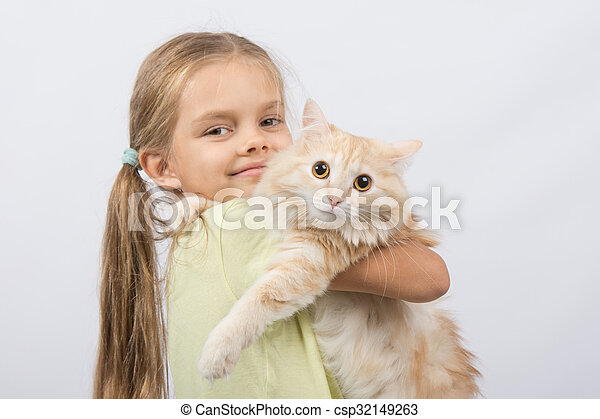 Six year old girl with a cat in her arms - csp32149263