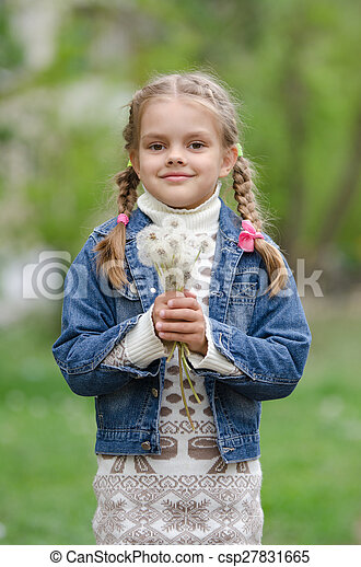 Six year old girl with dandelions - csp27831665
