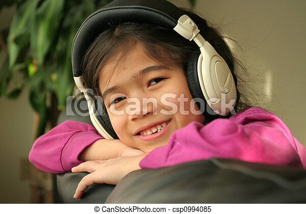 Six year old listening to music - csp0994085