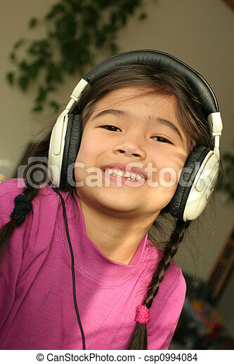 Six year old listening to music - csp0994084