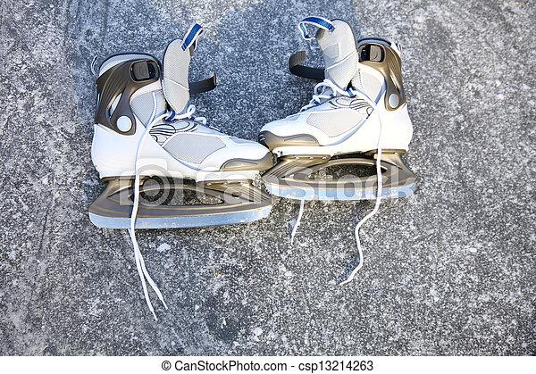 skate ice skates outdoors winter - csp13214263