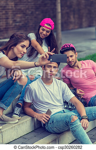 Skateboarder friends on the stairs, made selfie photo - csp30260282