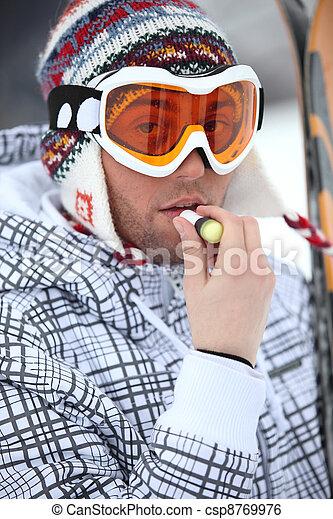 Skier applying lip balm - csp8769976