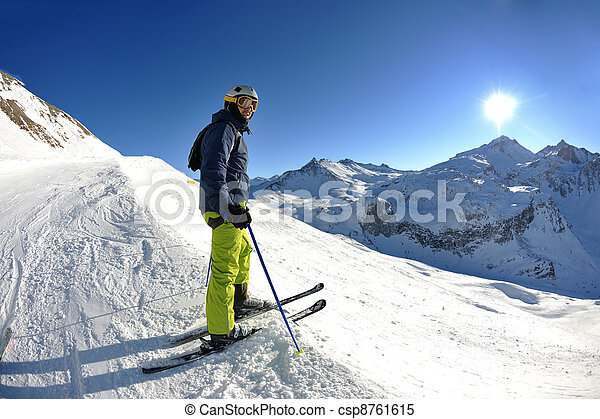 skiing on fresh snow at winter season at beautiful sunny day - csp8761615