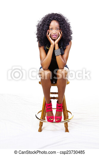 Skinny African American   Sitting Stool - csp23730485