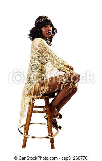 Skinny African American Woman Sitting Gold Shawl - csp31266770