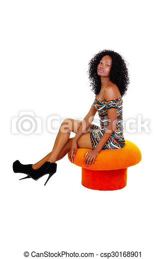 Skinny African American Woman Sitting Orange Stool - csp30168901