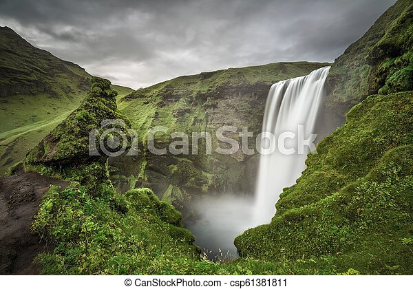 Skogafoss waterfall in southern Iceland from above - csp61381811