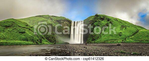 Skogafoss waterfall panorama in southern Iceland - csp61412326