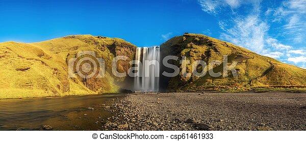 Skogafoss waterfall panorama in southern Iceland - csp61461933