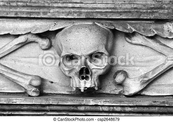 Skull carved in stone - csp2648679