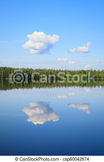 Sky reflects from lake at summer day - csp60042674
