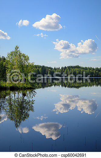 Sky reflects from lake at summer day - csp60042691