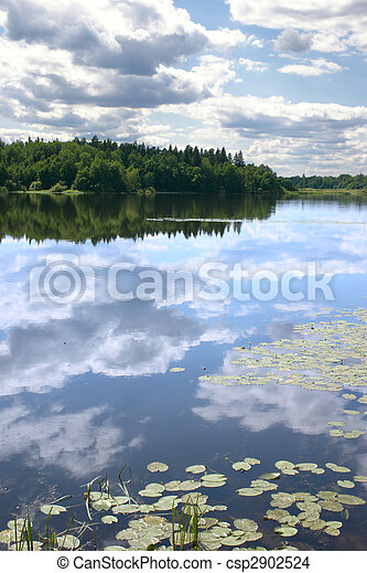 Sky reflexion in a water smooth surface - csp2902524