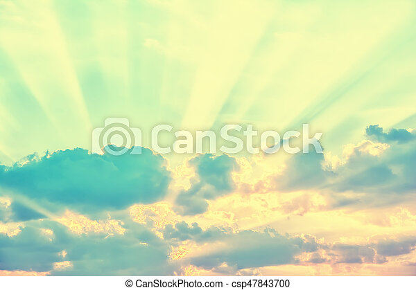 Sky with sun rays through the clouds - csp47843700