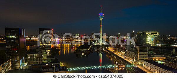 Skyline view of Dusseldorf at night blue hour - csp54874025