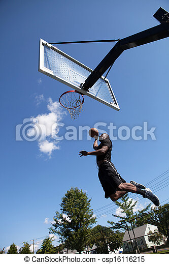 Slam Dunking a Basketball - csp16116215