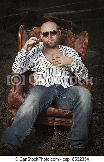 Sleazy Man in a Vintage Chair - csp18532354