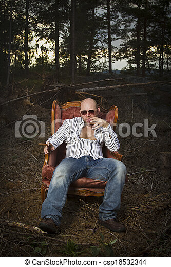 Sleazy Man in a Vintage Chair - csp18532344