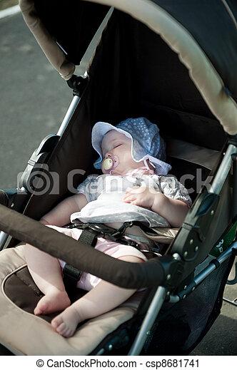 Sleeping baby in stroller - csp8681741