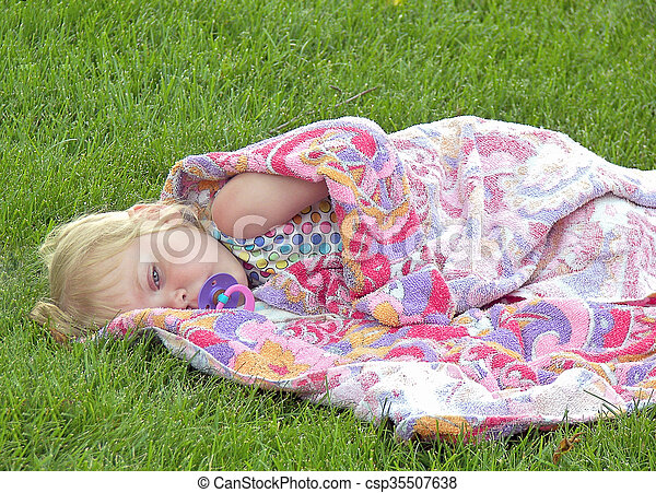 sleepy little girl with pacifier - csp35507638