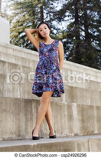 Slender Asian American Woman Standing Dress - csp24926296