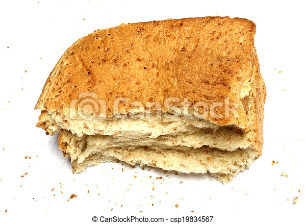 slice of bread with crumbs; isolated; white background - csp19834567