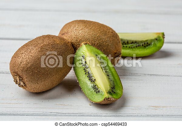 Slice of fresh kiwi fruit on white background - csp54469433