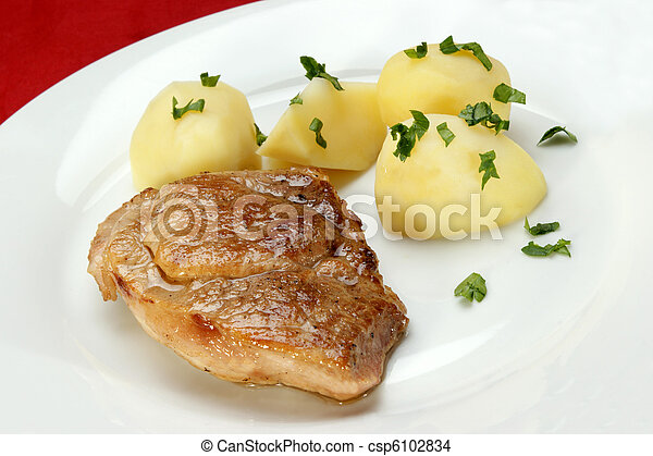 slice of roast pork with boiled potatoes - csp6102834